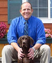 Dr. Justin Vaughn and Carter, his German Shorthair, at All Creatures Great and Small Vet Clinic in Corvallis, Oregon.